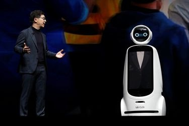 I.P. Park, president and chief technical officer for LG Electronics, speaks with a LG Cloi robot during a keynote address at the 2019 CES in Las Vegas