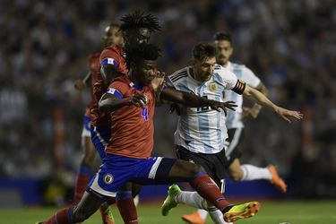 Argentina's Lionel Messi (R) vies for the ball with Haiti's Ricardo A