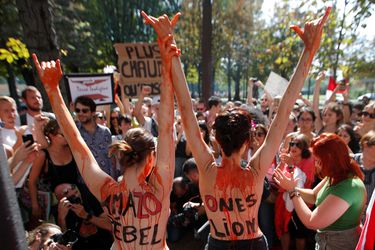Climate activists attend a protest outside the Brazil's embassy in Paris due the wildfires at Amazon rainforest