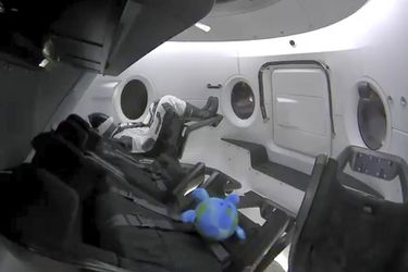 This photo provided by SpaceX shows a life-size test dummy along with