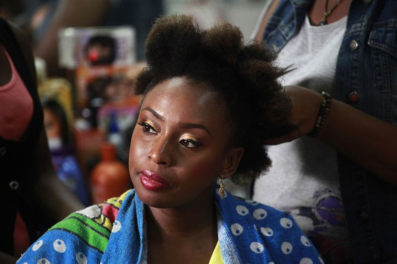 Nigerian novelist Chimamanda Ngozi Adichie sits in a salon for her hair-do in Victoria Island district in Lagos