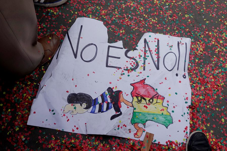 """A sign that reads """" No is No"""" is seen during a protest against Bolivia's President Evo Morales bid for re-election in 2019, in La Paz"""