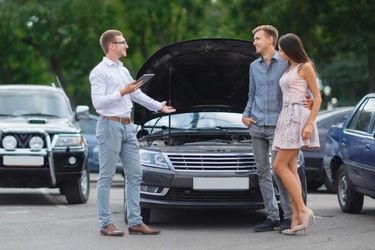 young-couple-buying-used-car-1068x600