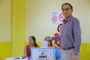 Peru's President Martin Vizcarra votes during a referendum on judicial and political reforms in Lima